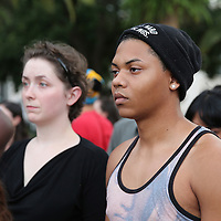 "People gather in Lake Eola park during the ""National Moment of Silence"" event at the Lake Eola bandshell in downtown Orlando, Florida on Thursday, August 14, 2014. In light of the recent killing of eighteen year old Mike Brown in Ferguson, Missouri, citizens across America are gathering in solidarity to hold vigils and observe a moment of silence to honor victims of suspected police brutality. (AP Photo/Alex Menendez)"