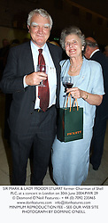 SIR MARK & LADY MOODY-STUART former Chairman of Shell PLC, at a concert in London on 30th June 2004.PWR 29