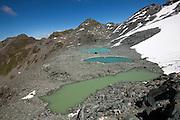 Glacial tarns along stage 6 of the Walker's Haute Route, between Cabane du Mont Fort and Cabane du Prafleuri, Switzerland.
