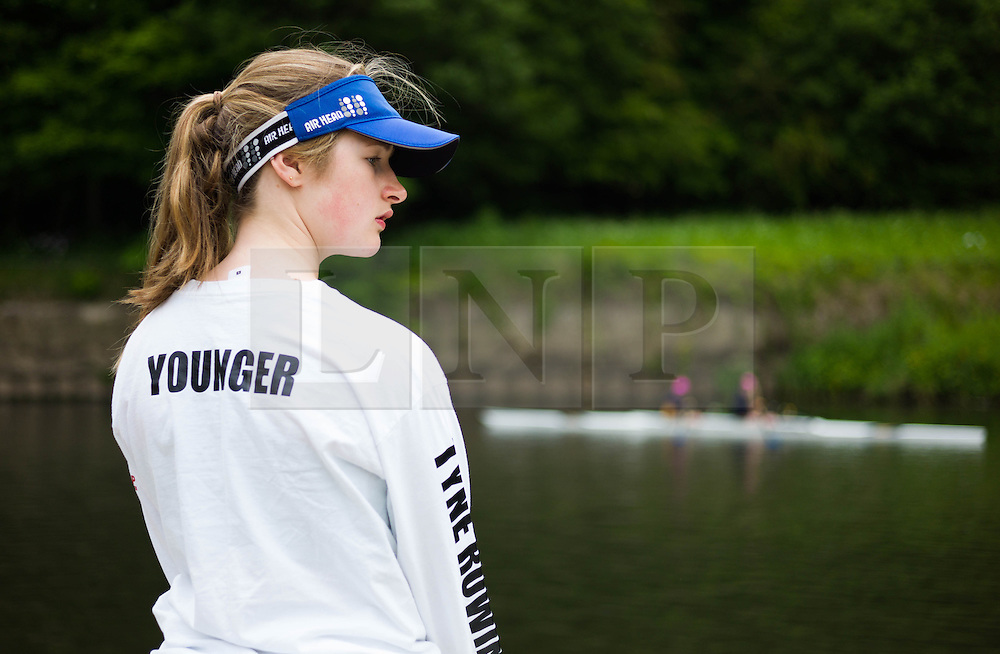 © Licensed to London News Pictures.13/06/15<br /> Durham, England<br /> <br /> A rower stands on the river bank during the 182nd Durham Regatta rowing event held on the River Wear. The origins of the regatta date back  to commemorations marking victory at the Battle of Waterloo in 1815. This is the second oldest event of this type in the country and attracts over 2000 competitors from across the country.<br /> <br /> Photo credit : Ian Forsyth/LNP