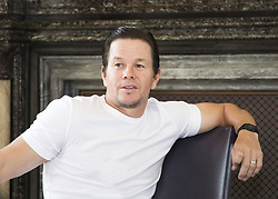 June 18, 2017 - London, United Kingdom - MARK WAHLBERG promotes 'Transformers: The Last Knight.' Mark Robert Michael Wahlberg (born June 5, 1971) is an American actor, producer, businessman and former model and rapper. He was known as Marky Mark in his earlier years, as frontman with the band Marky Mark and the Funky Bunch, releasing the albums Music for the People and You Gotta Believe. Wahlberg later transitioned to acting, appearing in films such as the drama Boogie Nights and the satirical war comedy-drama Three Kings during the 1990s. In the 2000s, he starred in the biographical disaster drama The Perfect Storm, the science-fiction film Planet of the Apes, and received an Academy Award nomination for Best Supporting Actor in the neo-noir crime drama The Departed. In the 2010s, he starred in the action-comedy The Other Guys, the biographical sports drama The Fighter (for which he earned an Academy Award nomination as a producer for Best Picture), the comedy Ted, the war film Lone Survivor and the science-fiction action film Transformers: Age of Extinction. Upcoming: The Roman (producer, announced), Patriots Day (2016 actor, producer). (Credit Image: © Armando Gallo via ZUMA Studio)