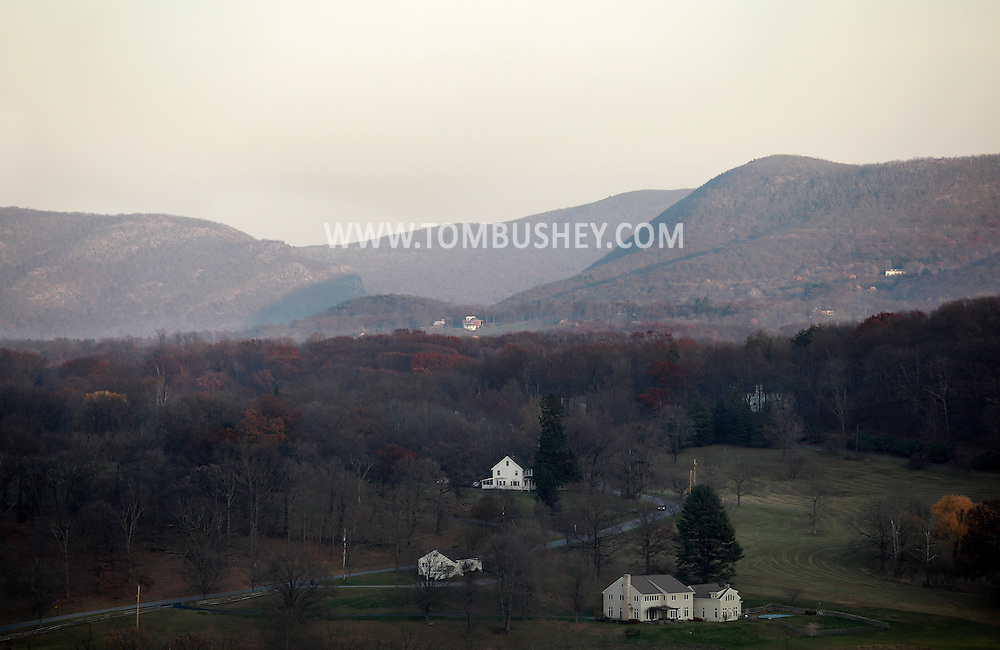 Salisbury Mills, New York - A view of country homes with the mountains of the Hudson Highlands in the background on Nov. 20, 2010. Storm King Mountain is in the background at right. The mountains in the background at left are on the eastern side of the Hudson River.