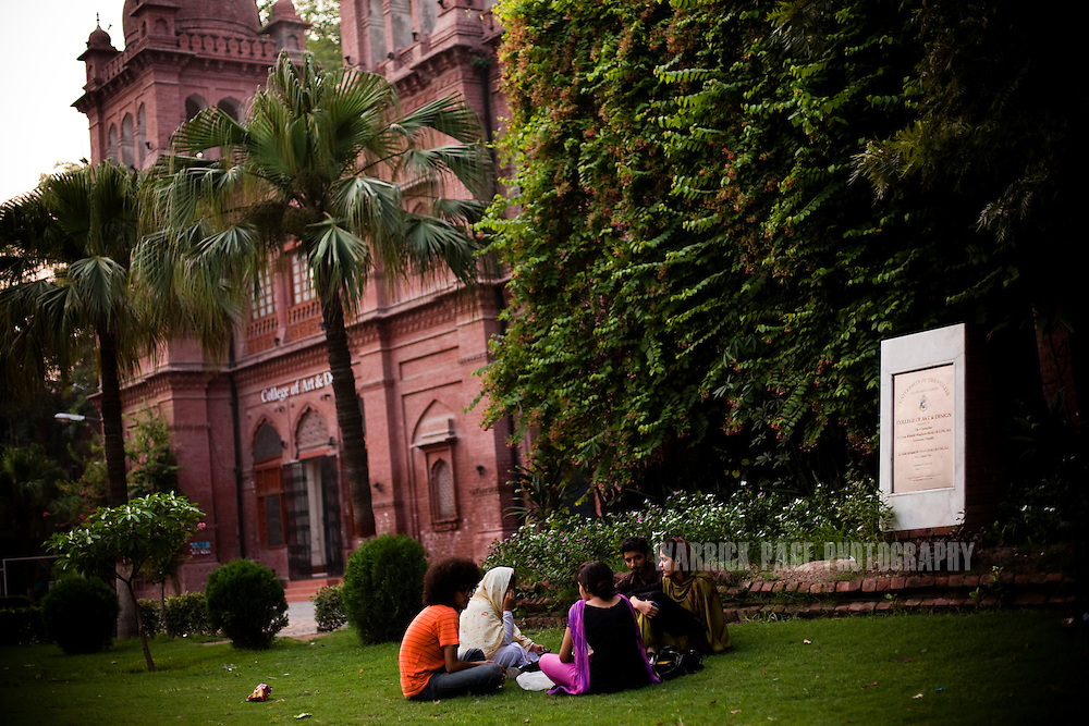 Male and female students talk outside on the lawn of Punjab University's old campus on July, 2011, in Lahore, Pakistan. Islamic groups are using increasing intimidation tactics in universities against progressive liberal youth throughout universities in Pakistan. (Photo by Warrick Page)