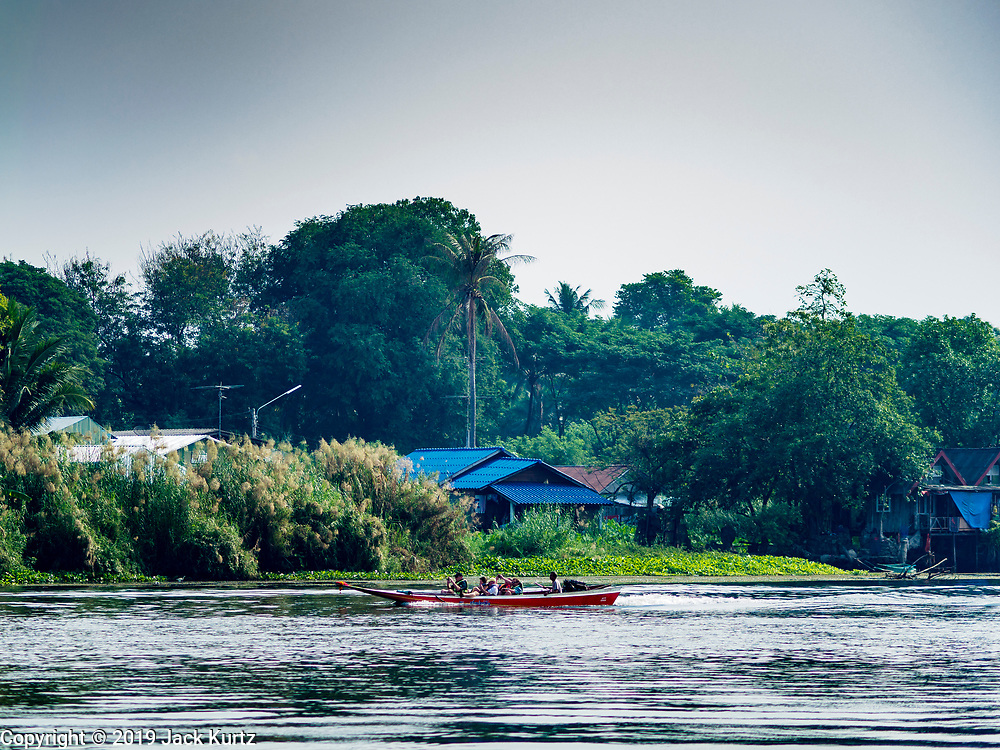 """09 JANUARY 2019 - KANCHANABURI, THAILAND: The """"Bridge On the River Kwai"""" in Kanchanaburi, Thailand. Hundreds of thousands of Asian slave laborers and Allied prisoners of war died in World War II making the railway between Bangkok and Rangoon (now Yangon), Burma (now Myanmar) for the Japanese.  Thailand has a very advanced rail system and trains reach all parts of the country.        PHOTO BY JACK KURTZ"""