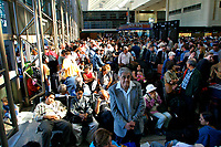 Jul 04, 2002; Los Angeles, CA, USA; International travelers wait in line just inside the Tom Bradley International terminal for hours before the suspected suicide bomber's dead body was removed from near the EL AL ticket counter at Los Angeles International airport in the Tom Bradley International terminal. <br />