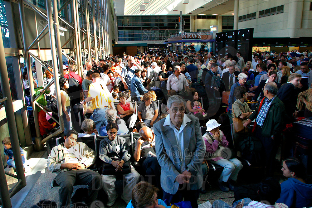 Jul 04, 2002; Los Angeles, CA, USA; International travelers wait in line just inside the Tom Bradley International terminal for hours before the suspected suicide bomber's dead body was removed from near the EL AL ticket counter at Los Angeles International airport in the Tom Bradley International terminal. <br />Mandatory Credit: Photo by Shelly Castellano/ZUMA Press.<br />(&copy;) Copyright 2002 by Shelly Castellano