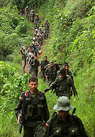 Police escort workers hired by the Colombian government to manually eradicate coca crops near La Via Alta, in a remote area of the southern Colombian state of Nariño, on Thursday, June 21, 2007. (Photo/Scott Dalton)