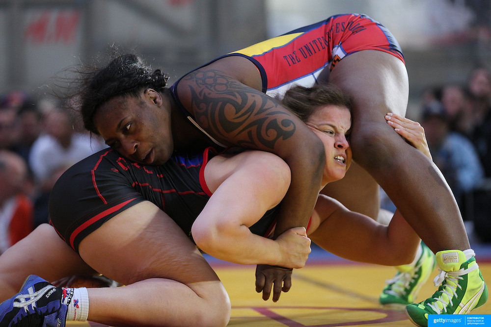 Randi Miller, (top), USA, in action against Alina Stadnik-Makhynia, Ukraine, during a women's wrestling bout at the 'Beat The Streets' USA Vs The World, International Exhibition Wrestling in Times Square. New York, USA. 7th May 2014. Photo Tim Clayton