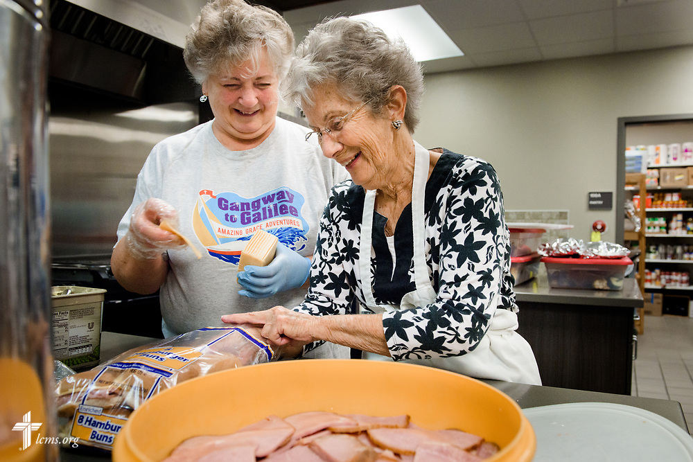 "Volunteers Kathy Gross (left) and Leone Christianson from Faith Lutheran Church, Sioux Falls, SD., prepare lunch together at the Bishop Dudley Hospitality House homeless shelter on Tuesday, Aug. 1, 2017, in Sioux Falls. The meals are provided by a grant through the ""Stand With Your Community"" program, which was made possible by a partnership between the LCMS, Thrivent Financial and Lutheran Church Extension Fund. LCMS Communications/Erik M. Lunsford"