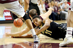 Vanderbilt's Jeff Roberson (11) fights for a loose ball agaisnt Texas A&M's Alex Caruso (21) during the second half of an NCAA college basketball game, Saturday, March 5, 2016, in College Station, Texas. Texas A&M won 76-67. (AP Photo/Sam Craft)