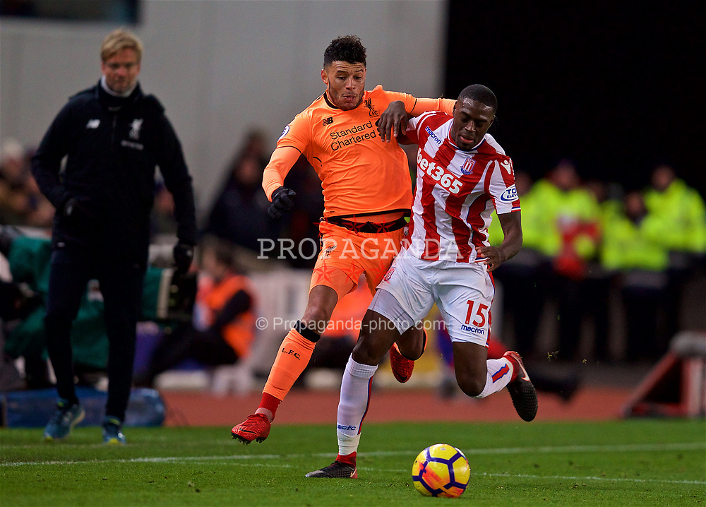 STOKE-ON-TRENT, ENGLAND - Wednesday, November 29, 2017: Liverpool's Alex Oxlade-Chamberlain is fouled byn Stoke City's Bruno Martins Indi during the FA Premier League match between Stoke City and Liverpool at the  Bet365 Stadium. (Pic by David Rawcliffe/Propaganda)
