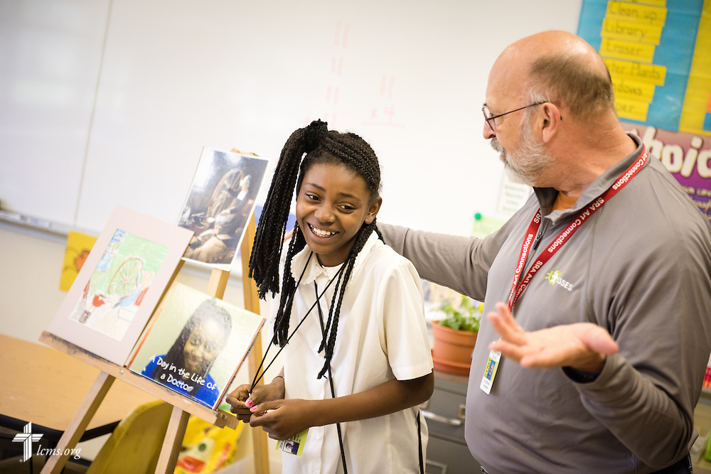 Dr. Bill Chandler, visual art consultant at Lutheran Special School & Education Services located in Milwaukee Lutheran High School, talks to Verna Jefferson during a classroom activity on Tuesday, May 19, 2015, in Milwaukee, Wis. LCMS Communications/Erik M. Lunsford