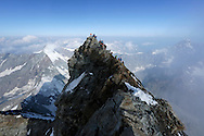 """Alpinists on the summit of Matterhorn.<br /> <br /> """"Matterhorn 150 years Cervino"""" - The year 2015 is the 150th Anniversary of the first ascent by Edward Whymper from the Swiss side (14th July) and by Jean Antoine Carrel from the Italian side on the 17th July 1865.<br /> <br /> On 17th July 2015 a friendship convention was signed by the members of Swiss, French, British and Italian climbing teams. A ceremony was held at the summit in honour of the mountain."""