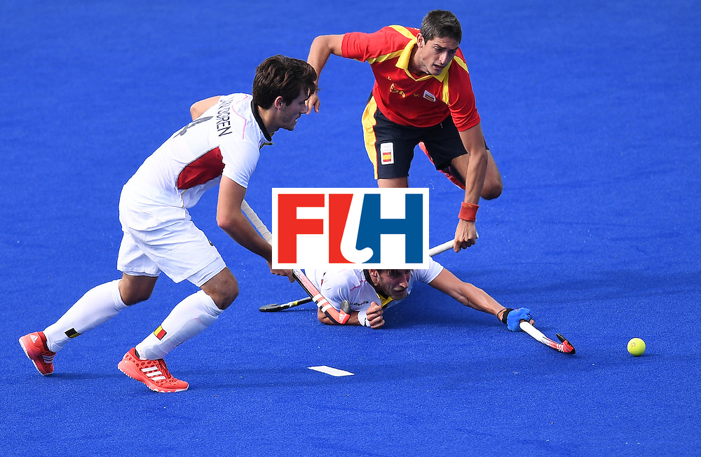 TOPSHOT - Belgium's Elliot van Strydonck (C) as Spain's Xavi Lleonart (R) and Belgium's Arthur van Doren chase the ball during the men's field hockey Spain vs Belgium match of the Rio 2016 Olympics Games at the Olympic Hockey Centre in Rio de Janeiro on August, 11 2016. / AFP / MANAN VATSYAYANA        (Photo credit should read MANAN VATSYAYANA/AFP/Getty Images)