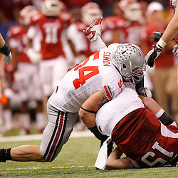 January 4, 2011; New Orleans, LA, USA;  Ohio State Buckeyes defensive lineman John Simon (54) sacks Arkansas Razorbacks quarterback Ryan Mallett (15) during the second quarter of the 2011 Sugar Bowl at the Louisiana Superdome.  Mandatory Credit: Derick E. Hingle