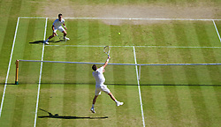 LONDON, ENGLAND - Friday, July 4, 2014: Novak Djokovic (SRB) looks on helpless as Grigor Dimitrov (BUL) smashes a winning point during the Gentlemen's Singles Semi-Final match on day eleven of the Wimbledon Lawn Tennis Championships at the All England Lawn Tennis and Croquet Club. (Pic by David Rawcliffe/Propaganda)