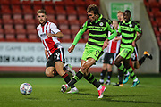 Forest Green Rovers Christian Doidge(9) shoots at goal saved by Cheltenham Town goalkeeper Jon Flatt(1) during the EFL Trophy match between Cheltenham Town and Forest Green Rovers at Whaddon Road, Cheltenham, England on 3 October 2017. Photo by Shane Healey.