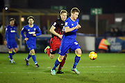 AFC Wimbledon defender Chris Roberston (34) clearing the ball during the EFL Sky Bet League 1 match between AFC Wimbledon and Coventry City at the Cherry Red Records Stadium, Kingston, England on 14 February 2017. Photo by Matthew Redman.