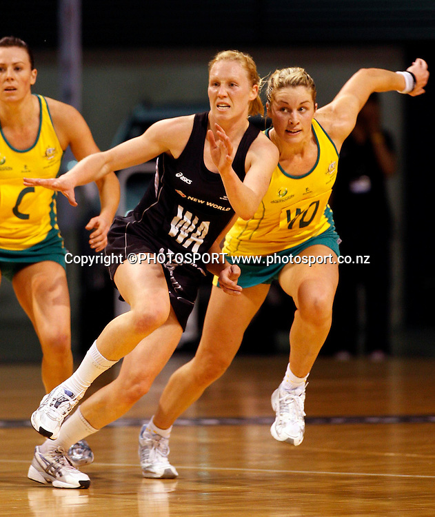 NZ WA Laura Langman races to the ball with WD Julie Prendergast.<br />