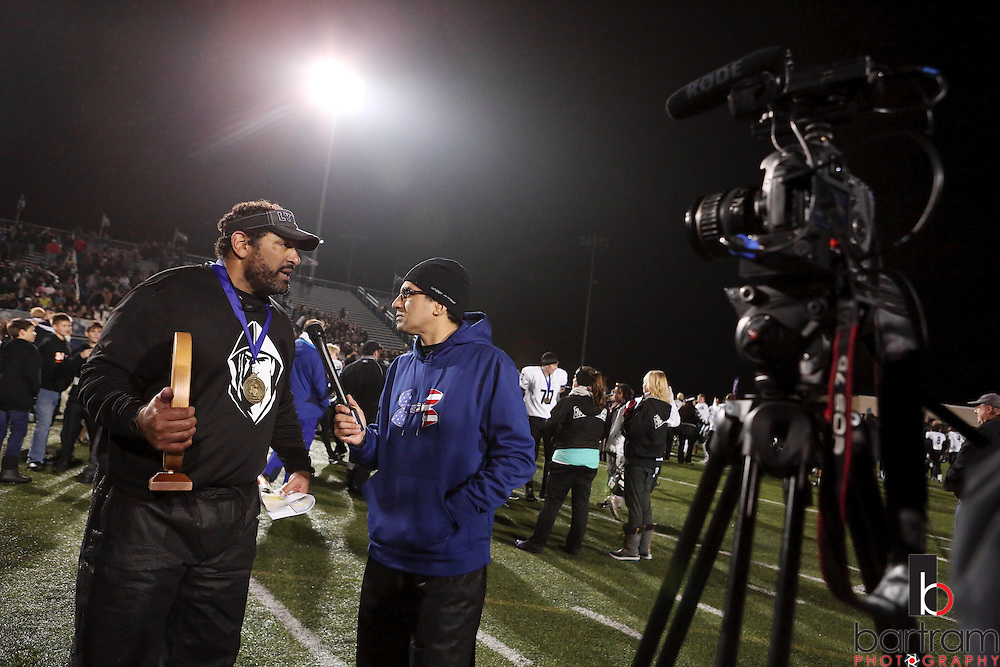 Bishop Lynch coach Chuck Faucette is interviewed following the TAPPS Division I state championship game on Saturday, Dec. 3, 2016 at Panther Stadium in Hewitt, Texas. Bishop Lynch High School won 21-17. (Photo by Kevin Bartram)