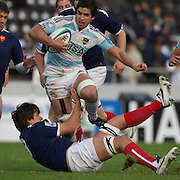 Tomas De La Vega, Argentina, is tackled by Georges Souvent, France,  during the Argentina V France group stage match at Estadio El Coloso del Parque, Rosario, Argentina, during the IRB Junior World Championships. 9th June 2010. Photo Tim Clayton....