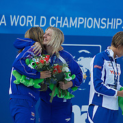 After seeing Federica Pellegrini of Italy break her World Record to win gold in the Women's 400m Freestyle, Rebecca Adlington, who won bronze congratulates team mate Joanne Jackson who finished second. at the World Swimming Championships in Rome on Sunday, July 7, 2009. Photo Tim Clayton..