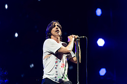 "© Licensed to London News Pictures. 14/06/2014. Isle of Wight, UK.   Red Hot Chili Peppers performing live at Isle of Wight Festival .   In this picture - Anthony Kiedis.  Red Hot Chili Peppers are an American rock band composed of members Anthony Kiedis (lead vocals),Michael ""Flea"" Balzary  (bass), Chad Smith (drums), Josh Klinghoffer (guitar, keyboards, backing vocals).   Isle of Wight festival is an annual music festival that takes place on the Isle of Wight. Photo credit : Richard Isaac/LNP"