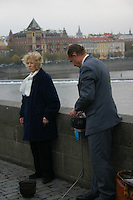 Opera singer busker on The Karluv, Charles medieval Bridge, Prague, River Vltava, Czech Republic<br />