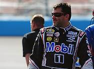 Nov. 12 2011; Avondale, AZ, USA; NASCAR Sprint Cup Series driver Tony Stewart (14) reacts on pit road during qualifying for the Kobalt Tool 500 at Phoenix International Raceway. Mandatory Credit: Jennifer Stewart-US PRESSWIRE