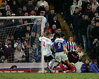 Photo: Lee Earle.<br /> Portsmouth v West Bromwich Albion. The Barclays Premiership. 17/12/2005. Portsmouth's Svetoslav Todorov (9) beats West Brom keeper Tomasz Kuszczak to open the scoring.