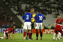 BELGRADE, SERBIA & MONTENEGRO - Wednesday, August 20, 2003: Referee Anders Frisk has words with Serbia & Montenegro's Ivica Dragutinovic (l) and Dejan Stankovic (r) after Wales' Craig Bellamy was tackled during the UEFA European Championship qualifying match at the Red Star Stadium. (Pic by David Rawcliffe/Propaganda)