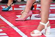 TAIYUAN, CHINA - JULY 03: (CHINA OUT) <br /> <br /> High-heel Race <br /> <br /> Participants take part in a high-heel race in front of a shopping mall on July 3, 2015 in Taiyuan, Shanxi Province of China. The winner got a diamond ring. <br /> ©Exclusivepix Media