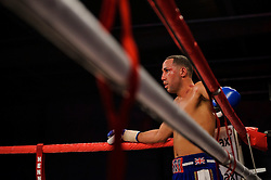 James DeGale (blue shorts) looks on from the corner after winning with an 11th round stoppage over Gevorg Khatchikian (white shorts) to defend his WBC Silver super middleweight title<br /> - Photo mandatory by-line: Rogan Thomson/JMP - Tel: 07966 386802 - 01/03/2014 - SPORT - BOXING - The City Academy, Bristol - James DeGale v Gevorg Khatchikian.