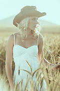 Cape Town model, Yolanda, wears cow girl clothes on the farm.