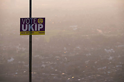 © Licensed to London News Pictures. <br /> 10/04/2015. <br /> Eston, United Kingdom<br /> <br /> A flag pole flying a St George flag displays a placard showing support for UKIP at the top of local landmark, Eston Nab on Teesside ahead of the General Election on May 7.<br /> <br /> Photo credit : Ian Forsyth/LNP
