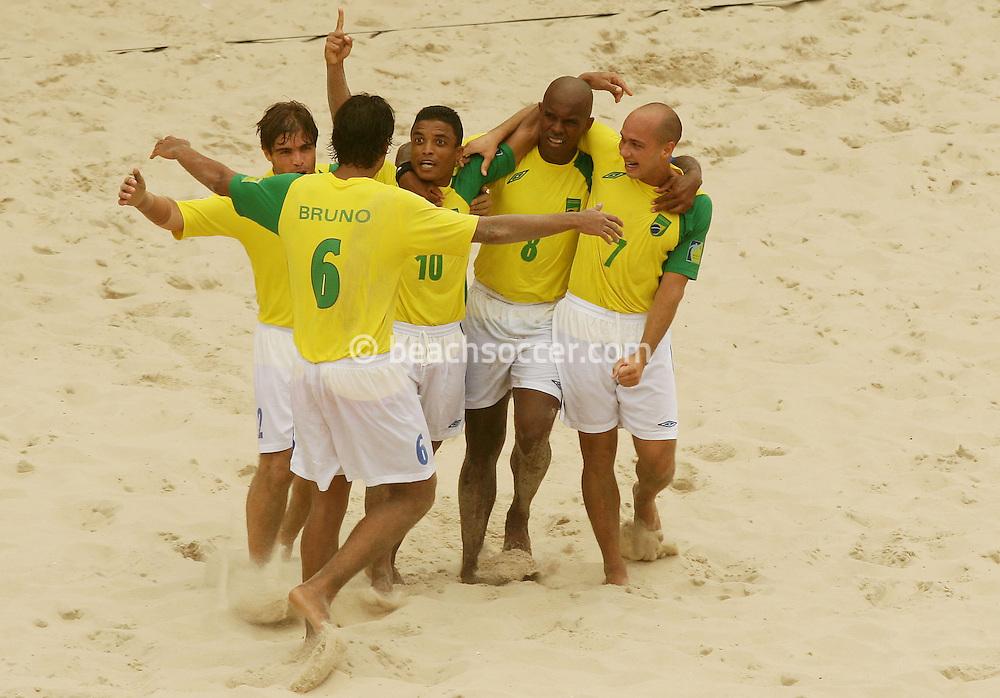 Football - FIFA Beach Soccer World Cup 2006 - Semi Final - BRA X POR - Rio de Janeiro - Brazil 11/11/2006<br />Benjamin (BRA) and his team-mates celebrates their victory against Portugal  Event Title Board Mandatory Credit: FIFA / Ricardo Moraes