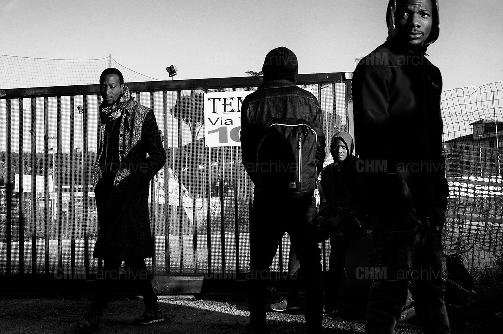 Migrants wait during the evacuation of a former penicillin factory where migrants from Africa but also Italians, lived in precarious conditions, on December 10, 2018 on via Tiburtina in Rome. Christian Mantuano / OneShot