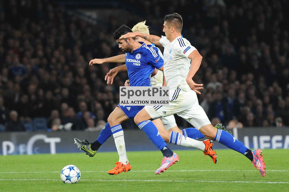 Chelseas Diego Costa goes down under pressure from Dynamo Kievs Aleksandar Dragovic and Yevhen Khacheridi in action during the Chelsea v Dynamo Kiev champions league match in the group stage on the 4th November 2015