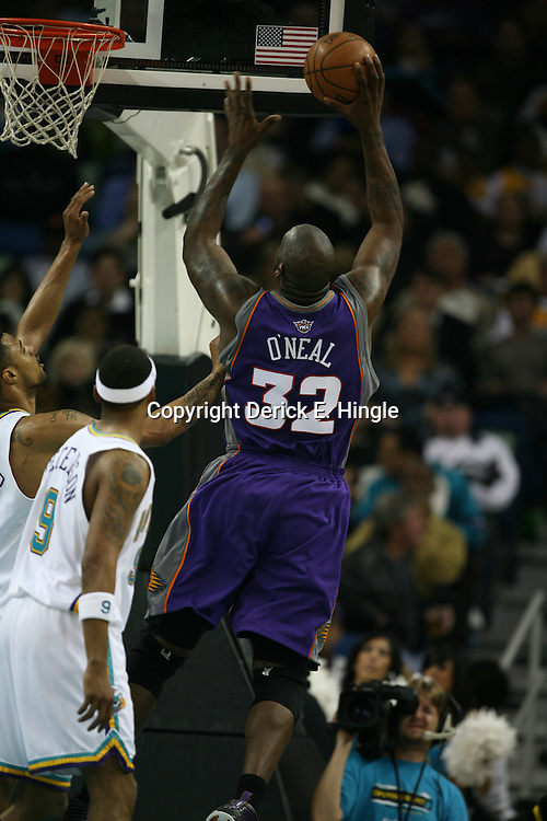 Shaquille O'Neal of the Phoenix Suns goes up for a shot on February 26, 2008 at the New Orleans Arena in New Orleans, Louisiana. The New Orleans Hornets defeated the Phoenix Suns 120-103.