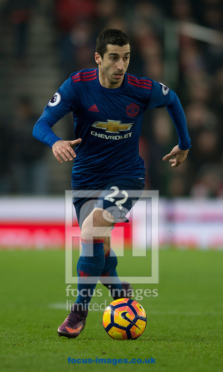 Henrikh Mkhitaryan of Manchester United brings the ball forward during the Premier League match at the Bet 365 Stadium, Stoke-on-Trent<br /> Picture by Russell Hart/Focus Images Ltd 07791 688 420<br /> 21/01/2017