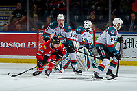 KELOWNA, CANADA - MARCH 3: Mason Mannek #26 of the Portland Winterhawks is checked by Dalton Gally #3 in front of the net of Roman Basran #30 of the Kelowna Rockets  on March 3, 2019 at Prospera Place in Kelowna, British Columbia, Canada.  (Photo by Marissa Baecker/Shoot the Breeze)