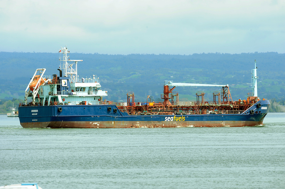 Oil fueling barge Awanuia heads out of Taraunga Harbour to attempt to off load further oil from the stricken container ship Rena grounded on the Astrolabe Reef, Mt Maunganui, New Zealand, Thursday, October 13, 2011. Credit:SNPA / Ross Setford