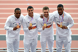 Chijindu Ujah, Adam Gemili, Daniel Talbot and Nethaneel Mitchell-Blake of Great Britain pose with their gold medals - Mandatory byline: Patrick Khachfe/JMP - 07966 386802 - 13/08/2017 - ATHLETICS - London Stadium - London, England - Men's 4x100m Metres Relay Medal Ceremony - IAAF World Championships