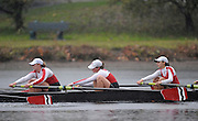 Cambridge, USA, Youth women' eights,  Community Rowing Inc. approach the John Weeks footbridge during the  2009 Head of the Charles  Sunday  18/10/2009  [Mandatory Credit Peter Spurrier Intersport Images],.