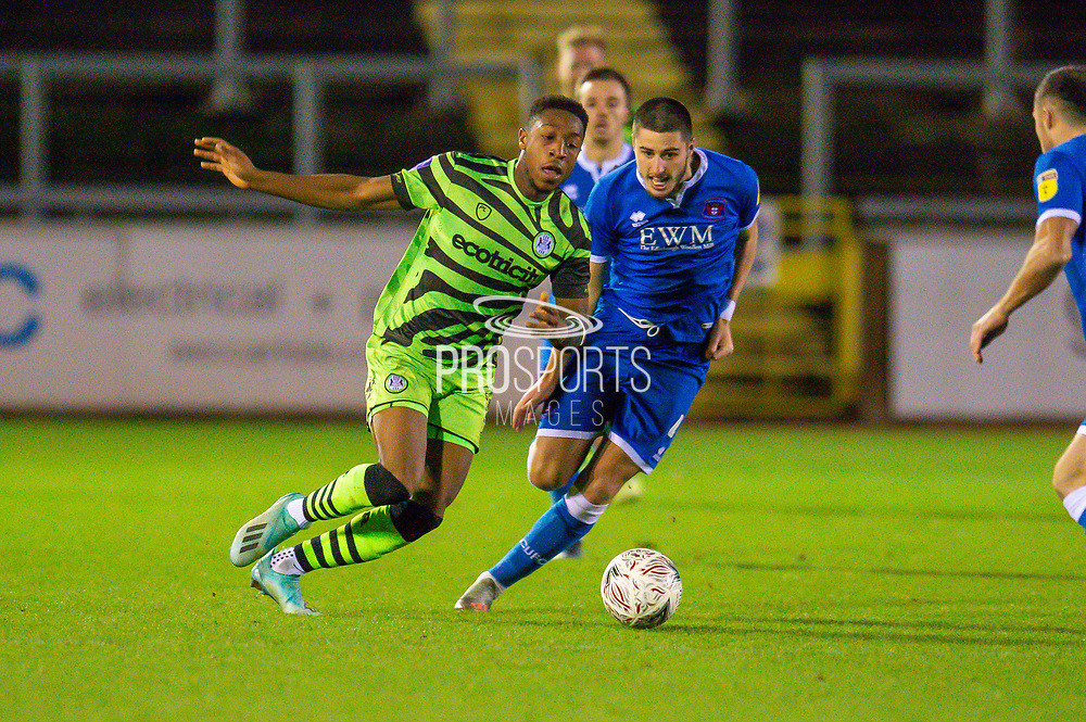 Ebou Adams (#14) of Forest Green Rovers runs past Canice Carroll (#4) of Carlisle United FC during the The FA Cup match between Carlisle United and Forest Green Rovers at Brunton Park, Carlisle, England on 10 December 2019.