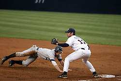 Firstbaseman Jeremy Farrell (17) attempts to make a pickoff play against Richmond.  UVA won the game 8-3.