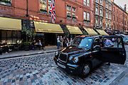 A London cab stops outside an hotel near Covent Garden