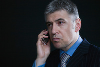 Worried Businessman on the Telephone
