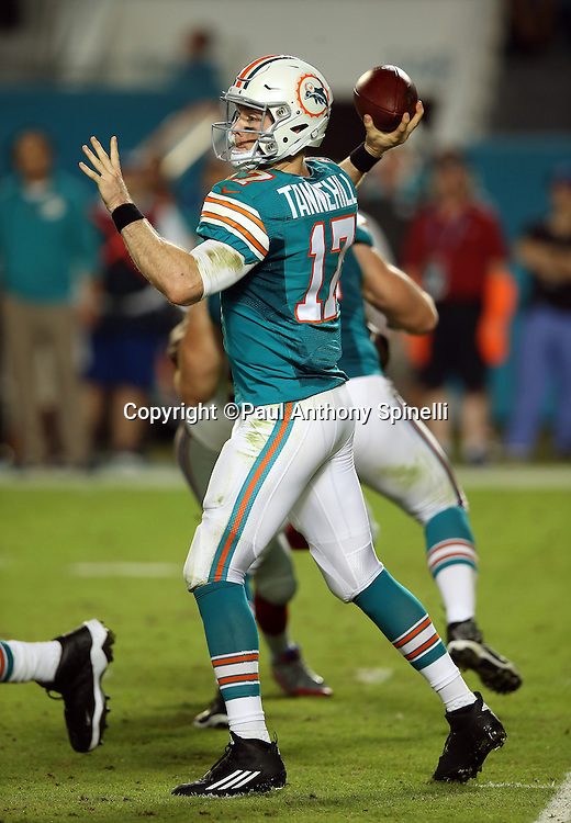 Miami Dolphins quarterback Ryan Tannehill (17) throws a second quarter pass for a completion during the NFL week 14 regular season football game against the New York Giants on Monday, Dec. 14, 2015 in Miami Gardens, Fla. The Giants won the game 31-24. (©Paul Anthony Spinelli)
