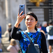 London, UK. 27 June 2019. UK Weather - Chinese lady taking a selfies at the Hottest week in June 2019 at Buckingham Palace, London, UK